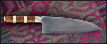 "8"" x 2.5"" Santoku, stainless bolsters, stabilized Redwood/Maple handle."